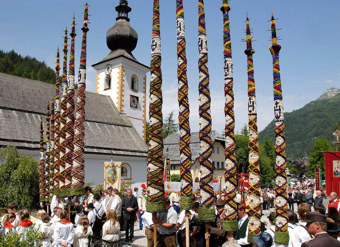 Tradition Lungau - Prangtag in Zederhaus in June with the magnificent pruning sticks, which adorn many thousands of flowers